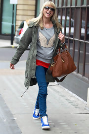 Sara Cox hit the streets of London showing off a tan leather shoulder bag.