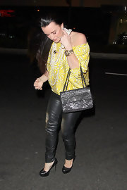 Kyle Richards added shine to her evening wear with a glittery chain strap purse.