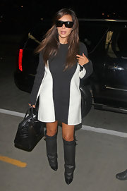 Kim Kardashian looks ready for fall fashion with these knee-high grey boots.