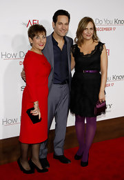 Julie wears opaque purple tights with matching accessories for the 'How Do You Know' premiere.