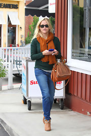 Reese Witherspoon showed off fall style in an orange scarf paired with tan ankle boots.