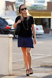 Strolling around Westwood has never looked so good. Unless of course you're Reese Witherspoon. She showed off her unique style while donning a long gold chain.