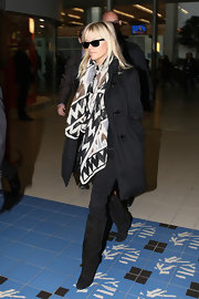 Reese Witherspoon added life to a basic black toggle coat with a bold tribal print scarf.