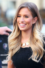 Renee Bargh accessorized her tweed LBD with a chunky gold necklace.