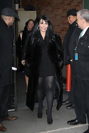 Renee Graziano threw a black fur coat on over her itty bitty black dress.