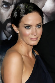 Emily Blunt added a little flair to her polished look with a peacock feathered hair pin.