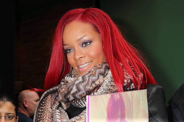 rihanna red hair curly. Red-haired Rihanna signs for