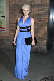 Accessorizing in black, she is carrying this black patent leather clutch. The black in her outfit helps the beautiful blue in her gown glow.