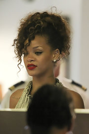 Rihanna wore her tresses in a high ponytail with tumbling curls while out for an evening in Portofino.