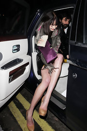 Lily Cole enjoyed a night out in London carrying a classy purple satin clutch.