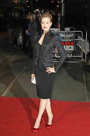 Evan Rachel Wood looked sophisticated in a black jacquard coat with a feminine tie waist.