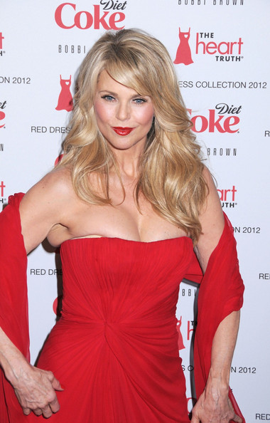 Christie Brinkley wore her hair in long flowing layers with side-swept bangs at the Heart Truth's Red Dress Fashion Show.