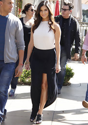Roselyn Sanchez broke up her black skirt and shoes with a white jersey halter.