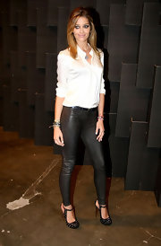 Ana Beatriz Barros played with contrasts during Sao Paulo Fashion Week, pairing a classic white silk blouse with edgy leather skinnies.