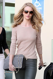 Rosie's nude ribbed sweater was refreshingly simple and luxurious.