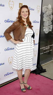 Sarah Drew looked casual and chic in a brown leather cropped jacket at the Rosie Pope Maternity Store Opening.