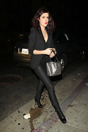 Rumer Willis paired her streamlined pants with of the moment studded ankle boots.