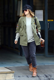 Drew Barrymore kept her style grungy in gray pants and scuffed boots.