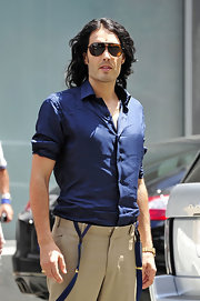 Russell Brand showed off his navy blue button down shirt while filming his new movie.