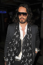 Russell Brand is a man of many scarves, as he proved with this cross-print piece.