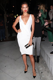 Irina Shayk showed off her curves in a white silk crepe wrap dress while attending the Marc Tetro Art Gallery opening.