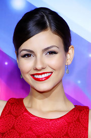 Victoria Justice pearly whites glowed beneath her bright cherry-red lips at the 2012 Halo Awards.