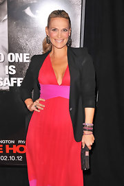 Molly Sims winterized her color-block halter dress with a simple black blazer.