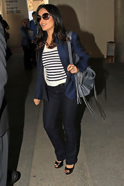 Salma Hayek sported a sleek navy blazer over a nautical-inspired top while traveling to LA.