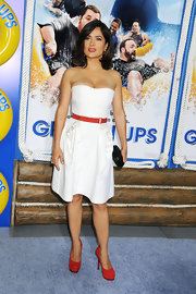 Salma looked sweet in a red-belted YSL dress with suede, platform Tribtoo Pumps.