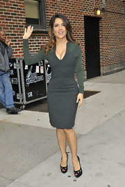 Salma Hayek topped off her figure-flattering sheath dress with black cut-out peep-toe pumps.