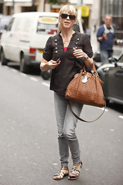 Sara Cox showed off her tan leather shoulder bag while hitting Radio One Studios.