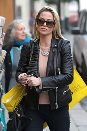 Sarah Harding toughened a fuzzy blush sweater with a zipper leather jacket.