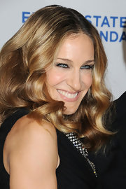 Sheer pink lipgloss keeps SJP's evening look finished but soft.