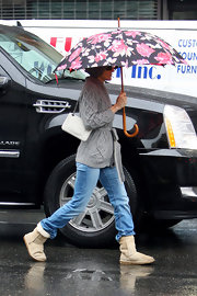SJP showed off her white chain strap bag while walking her son James to school.