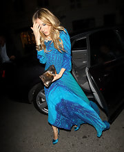 SJP looked stunning in a flowing print dress with vibrant satin pumps.