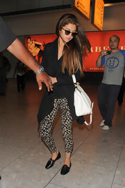 Selena let her printed pants act as a statement piece for her all-black ensemble!