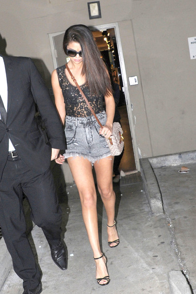Selena Gomez rocked the '80s trend of high-waisted denim shorts while out shopping.
