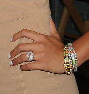 Cassie paired her flesh tone dress with colorful bangle bracelets with rhinestone embellishments.
