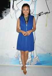 Jeannie Mai looked chic and modern in a zippered blue dress during Mercedes-Benz Fashion Week.