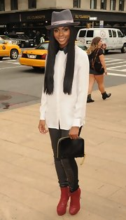 Tika Sumpter accessorized with a black zip-around clutch as she watched shows during Mercedes-Benz Fashion Week.