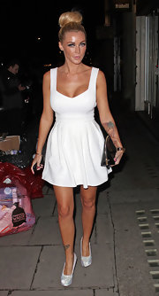 This sweet white dress accentuated Holly's curves.