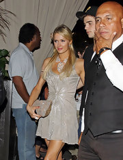 Paris Hilton kept her look glitzy and glamorous with this sequin skull-printed pouch.
