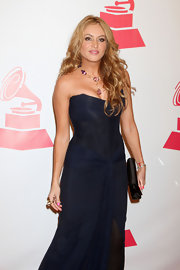 Paulina Rubio accented her glam gown with a simple black satin clutch at the Latin Grammys.