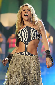 Shakira performed wearing wrapped, fringe cuff bracelets on both arms.