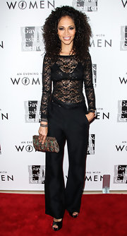 Sherri Saum looked seductive at the Evening with Women gala in a sheer black lace blouse.