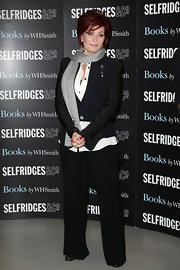 Sharon Osbourne wore a gray scarf at the launch of her debut novel, 'Revenge.'