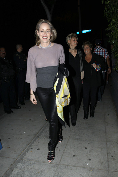 Sharon Stone paired her risqué ensemble with black leather cage sandals.
