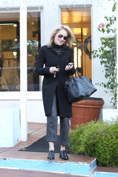 Sharon Stone visited the salon in a pair of flat black oxfords.