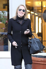 Sharon Stone carried a black snakeskin tote to her hair salon.