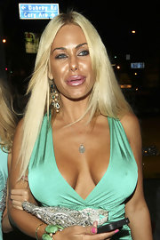 Shauna Sand glammed up her look with a pair of chunky gemstone chandelier earrings during a night out at Boa Steakhouse.